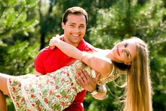Young love couple smiling outdoors Stock Photo