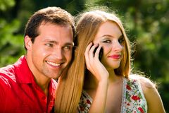 Young love couple smiling outdoors Stock Photos