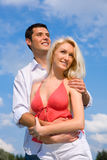 Young love Couple smiling under blue sky Stock Images