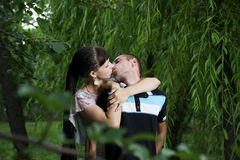 Young lovebirds. Young kissing lovebirds in nature Stock Image