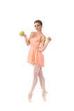 A young and lovelty ballet dancer holding a fresh apple Stock Photography