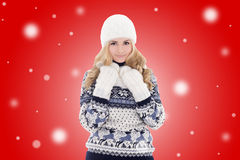 Young lovely beautiful girl in winter clothes over red backgroun Royalty Free Stock Photo