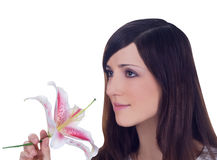 Young lovely brunette with flower Stock Photo