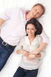 A young and lovely Caucasian couple on white Stock Photo