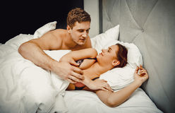 Young lovely couple in bed. Royalty Free Stock Photos