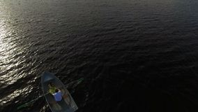 Young lovely couple boating aerial. Shot stock video