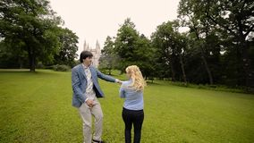 Young lovely couple dancing in a park in summer. Romantic dating or lovestory.  stock video footage