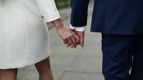Young lovely couple holding hands and walking stock video