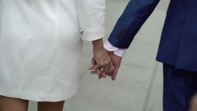Young lovely couple holding hands and walking stock footage