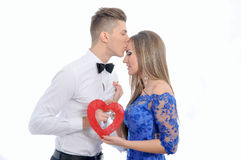 Young lovely couple holding red heart together Stock Images
