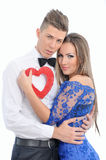 Young lovely couple holding red heart together Royalty Free Stock Photo