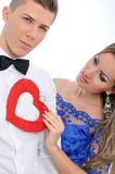 Young lovely couple holding red heart together Royalty Free Stock Images