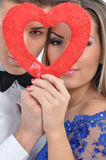 Young lovely couple holding red heart together Royalty Free Stock Image
