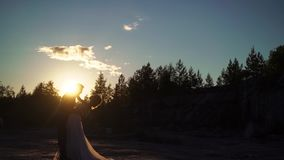 Young lovely couple hugging silhouette stock footage