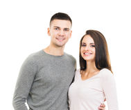 Young and lovely couple isolated on white Royalty Free Stock Photography