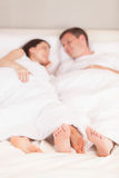Young lovely couple lying in bed. Stock Images