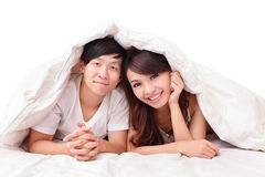 Young lovely couple lying in a bed Stock Image