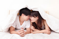 Young lovely couple lying in a bed Stock Photo