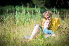 Young lovely couple lying in high grass Stock Photo