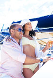 Young and lovely couple relaxing on a boat Royalty Free Stock Images
