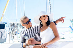Young and lovely couple relaxing on a boat Stock Images