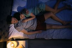 Young lovely couple sleeping in bed. At home stock image