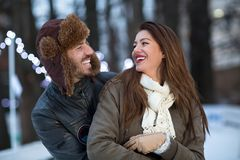 Young couple smiling and enjoy at wintertime moments Royalty Free Stock Images