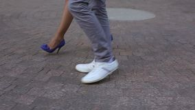 Young lovely couple walking in a city stock video footage