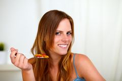 Young lovely girl eating breakfast Royalty Free Stock Photos