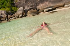 Young lovely girl relaxing in ocean on the beach royalty free stock photography