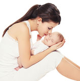 Young lovely mother kissing baby Stock Images