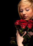 Young lovely woman with a bouquet of red roses Stock Photos