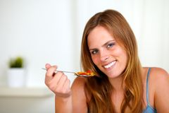 Young lovely woman eating breakfast Royalty Free Stock Images