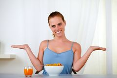 Young lovely woman eating healthy breakfast Royalty Free Stock Photo
