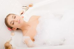 Young lovely woman in foam bath Royalty Free Stock Images