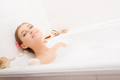 Young lovely woman in foam bath Royalty Free Stock Photos