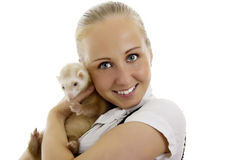 Young lovely woman with little ferret. Royalty Free Stock Photos