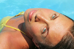 Young lovely woman in the pool. Looking at camera Royalty Free Stock Photo