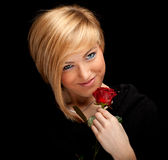 Young lovely woman with red rose Stock Photography