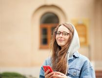 Young lovely woman with smartphone stock image