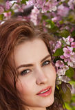 Young lovely woman in spring flowers royalty free stock photos