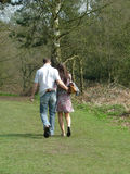 Young lovers. Walking in the spring sunshine Royalty Free Stock Photos
