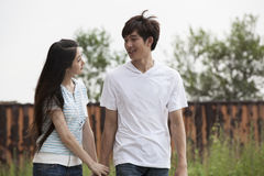 Young lovers. A young Asian couple is playing outdoor Royalty Free Stock Images