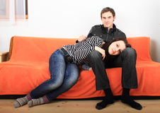 Young lovers on couch Royalty Free Stock Photography