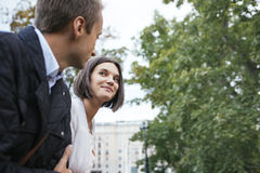 Young lovers couple smiling and laughing outdoors Stock Photo