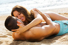 Young lovers having  date at sandy beach Royalty Free Stock Images