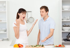 Young lovers having dispute in the kitchen Royalty Free Stock Images