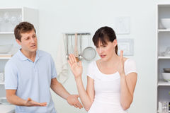 Young lovers having dispute in the kitchen Stock Image