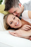 Young lovers having fun together on a sofa Royalty Free Stock Images