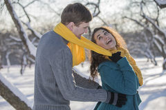 Young lovers having fun in winter clothes in the Park. Elegant w Stock Photo